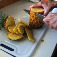 removing the outer layer of the pineapple